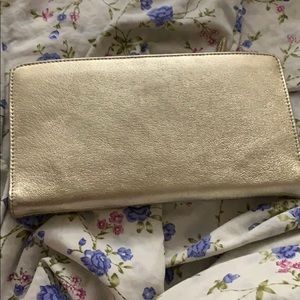 Tusk leather clutch